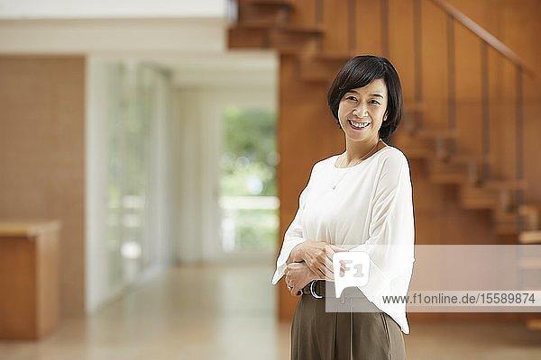 Senior Japanese woman at home