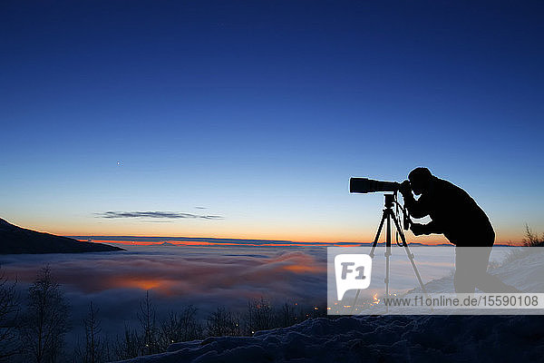 Silhouette Of Photographer At Sunset In Eagle River Valley  Southcentral  Alaska  Winter