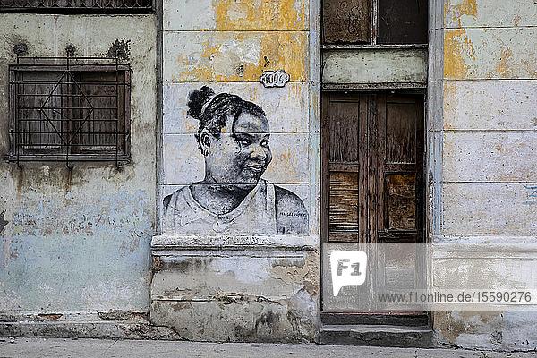Graffiti art portrait of a girl on a wall of a building in Central Havana; Havana,  Cuba