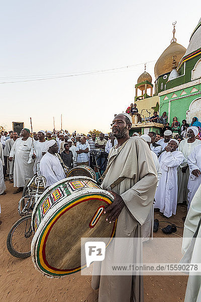 Sufi drummer at the dhikr  or remembrance of Allah  devotional ceremony at the Hamid el-Nil mosque; Omdurman  Khartoum  Sudan