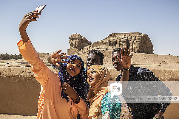 Sudanese students taking a self-portrait with a smart phone; Kerma  Northern State  Sudan