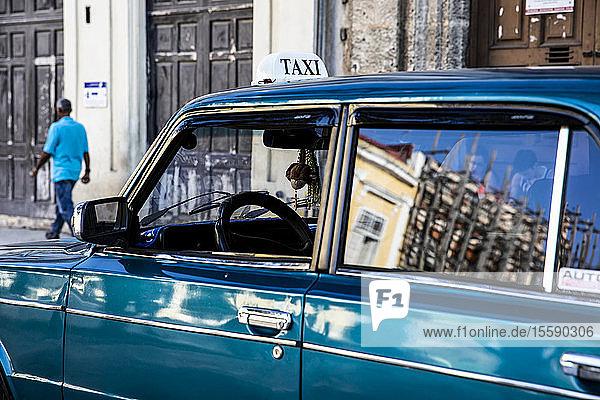 An old taxi on the streets of Havana; Havana,  Cuba