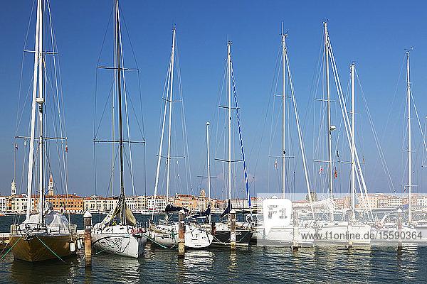 Sailboats moored in marina on Island of San Giorgio Maggiore; San Giorgio Maggiore,  Venice,  Veneto,  Italy