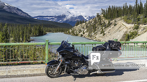 Motorcycle parked on the roadside of the Icefield Parkway on a bridge over the Athabasca River; Improvement District No. 12  Alberta  Canada