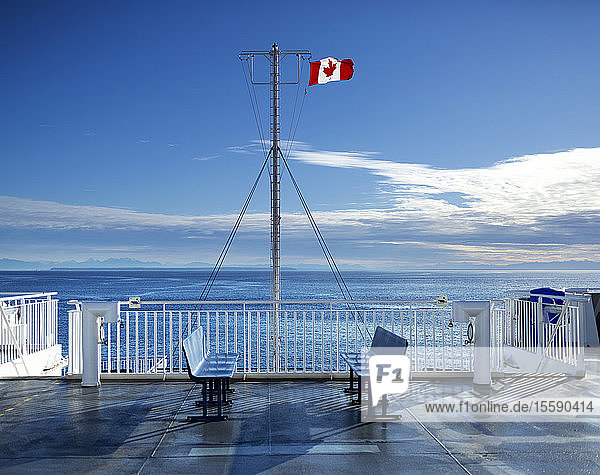 Deck of the new BC Ferry with a Canadian Flag  going to Mayne Island; British Columbia  Canada
