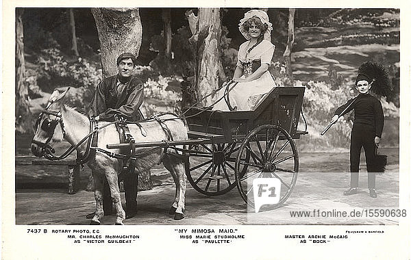 Postcard circa 1900 Victorian/Edwardian  social history. Black and white photograph of Mr Charles McNaughton  Miss Marie Studholme and Archie McCaid with horse and cart  from 'My Mimosa Maid' musical; London  England