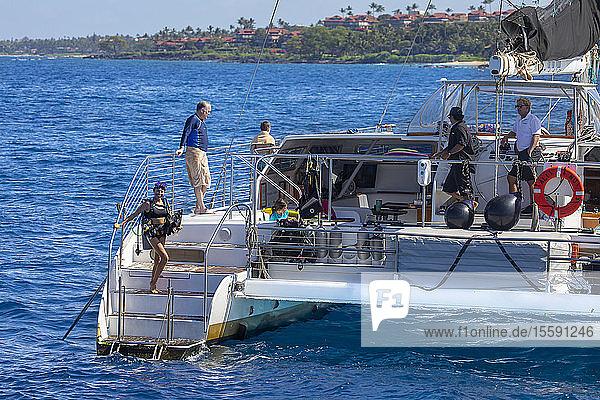 Diver on the vessel Alii Nui off the coast of Maui; Maui  Hawaii  United States of America