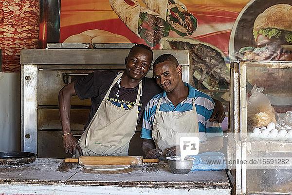 Cooks preparing a pizza; Ed Damer  Northern State  Sudan