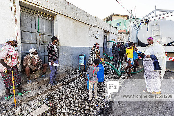 People by a water truck in Harar Jugol  the Fortified Historic Town; Harar  Harari Region  Ethiopia