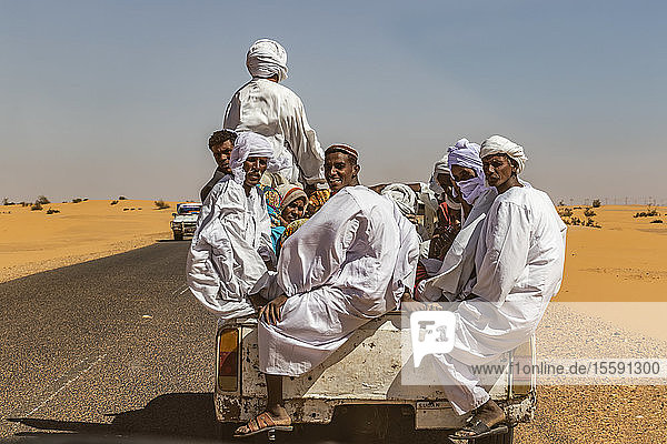 Sudanese men riding in the back of a Toyota pick-up truck; Old Dongola  Northern State  Sudan