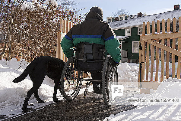 Woman with multiple sclerosis leaving home with a service dog