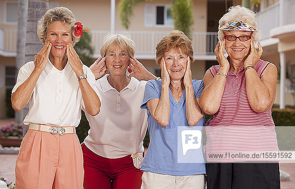 Portrait of four female friends wanting facelifts