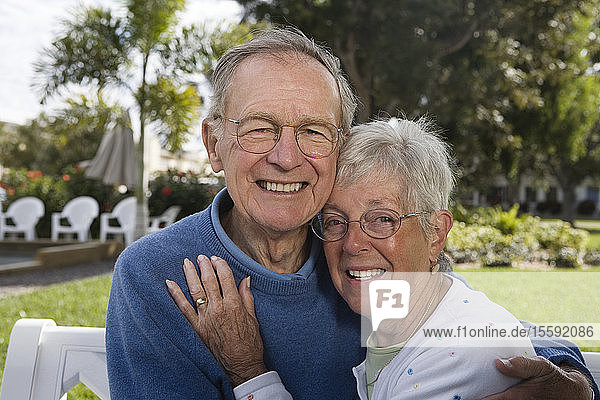 Portrait of a senior couple in a park.