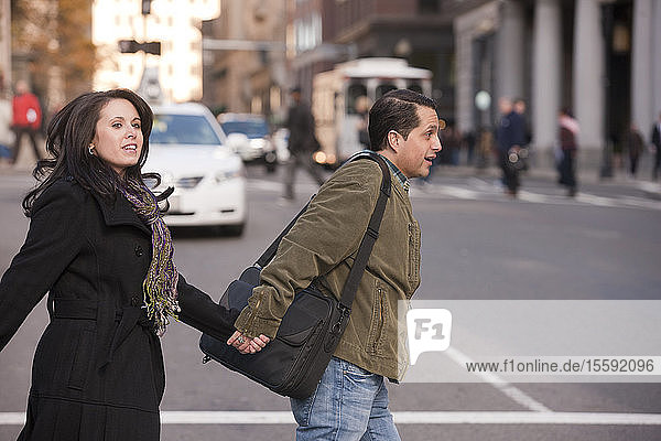 Couple crossing a street