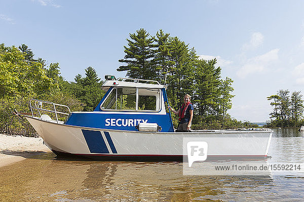 Public works engineer on security boat in reservoir