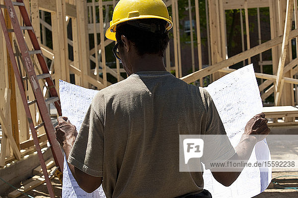 Construction manager reading a blueprint