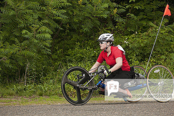 Woman with degenerative hip participating in a handcycle race