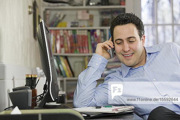 Hispanic businessman talking on a mobile phone
