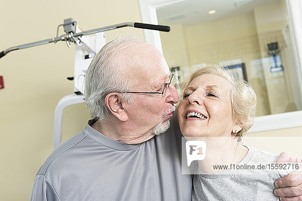 Senior couple smiling in the gym.