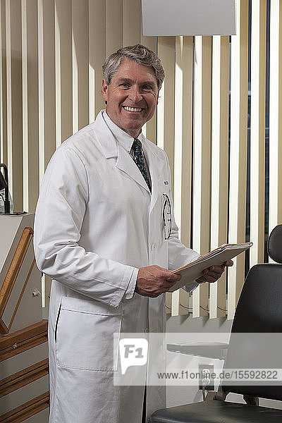 Ophthalmologist examining a medical report