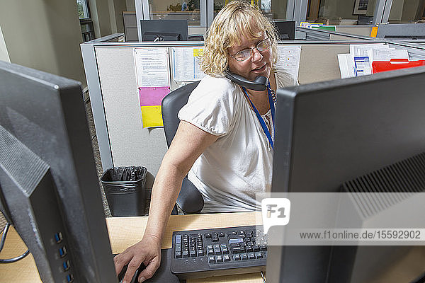 Female executive working in customer service center of electric power plant