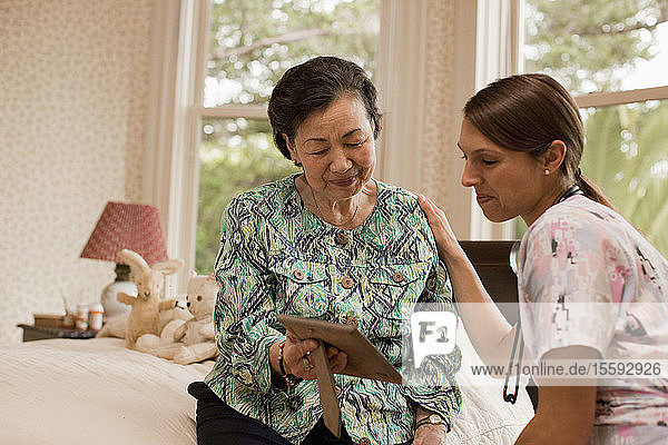 Senior woman receiving a visit at home from her nurse