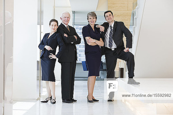 Portrait of businesspeople smiling in an office.