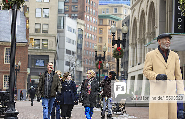 Tourists walking in front of Faneuil Hall Plaza  Boston  Suffolk County  Massachusetts  USA