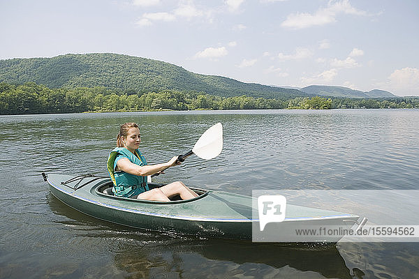 Young woman kayaking in a lake