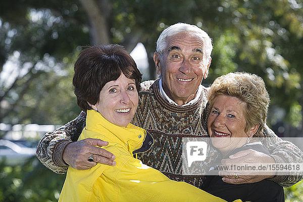 Portrait of friends smiling.