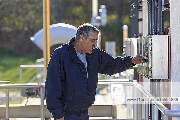 Engineer at water treatment control panel