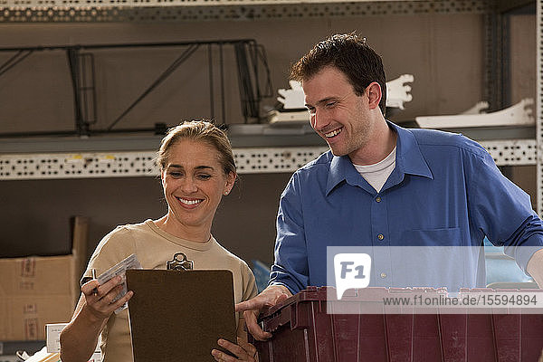 Supervisors counting inventory in a hardware store