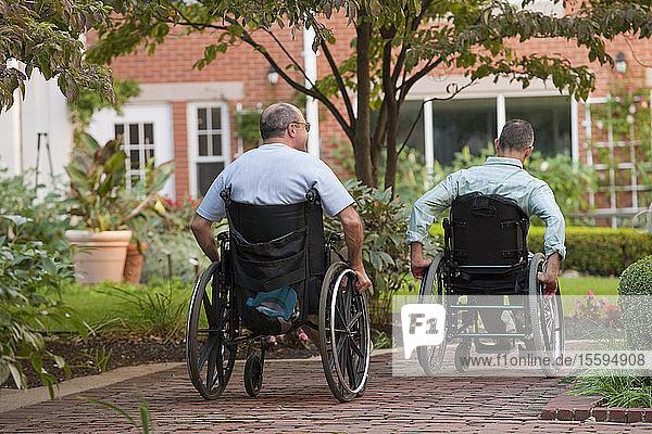 Men sitting in wheelchairs