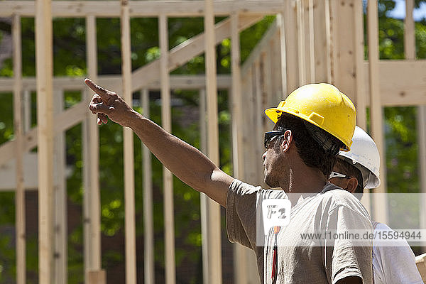 Carpenters planning at a construction site
