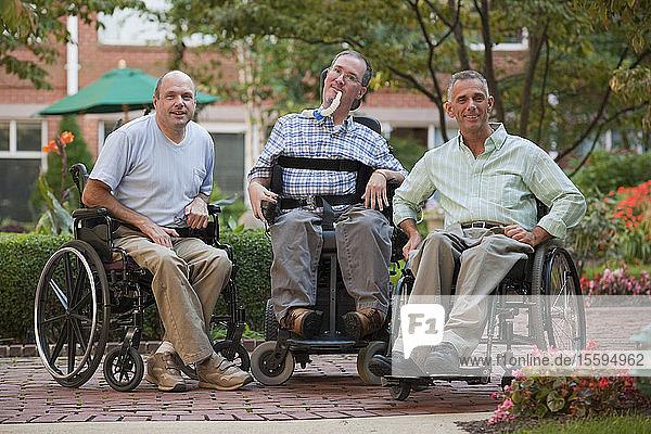 Three men sitting in wheelchairs