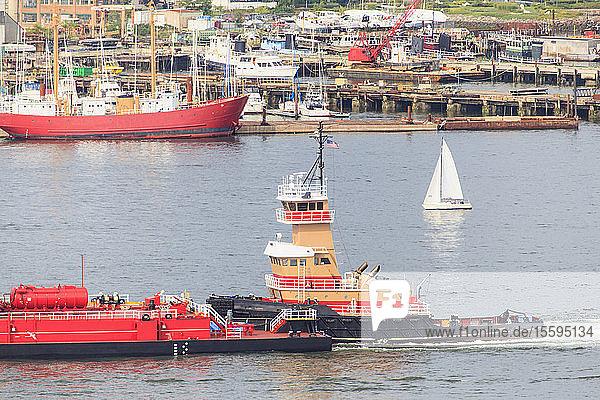 Tugboat moving tanker through Boston Harbor  East Boston  Boston  Massachusetts  USA