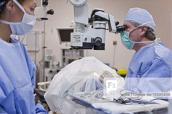 Ophthalmologist performing cataract surgery