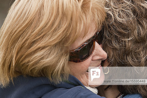 Close-up of two women hugging each other