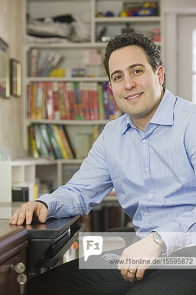 Hispanic businessman sitting in a home office