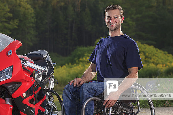 Man with spinal cord injury with his custom adaptive motorcycle
