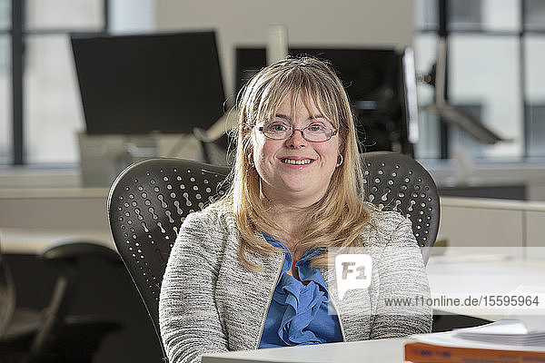 Young woman with Down Syndrome working in an office
