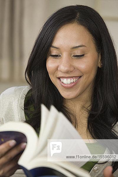 Hispanic woman holding a book