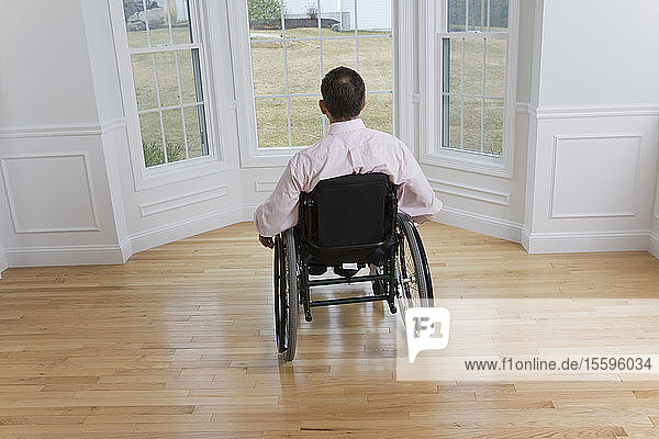 Rear view of a man sitting in a wheelchair