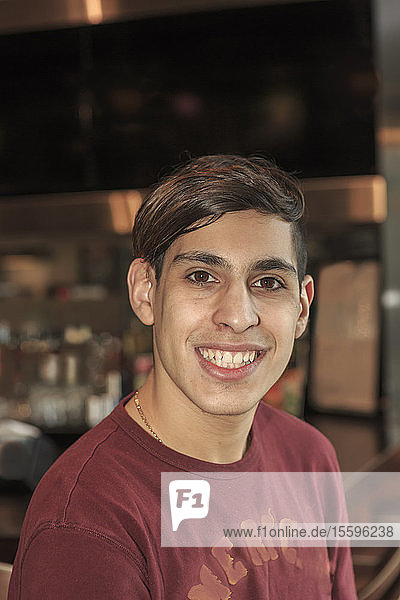 Young man with Fragile X Syndrome working in a restaurant