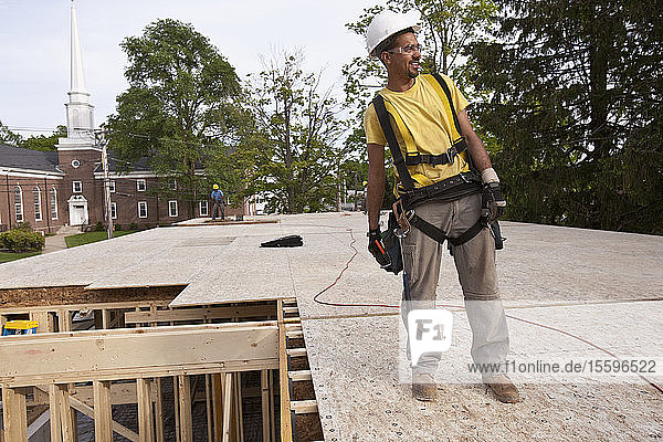 Carpenter standing on second floor particle board