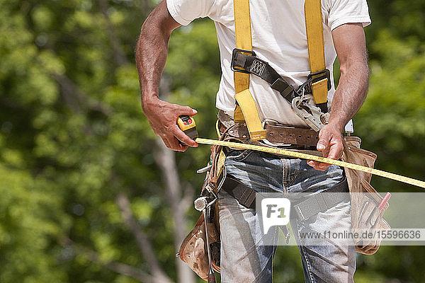 Carpenter making measurements