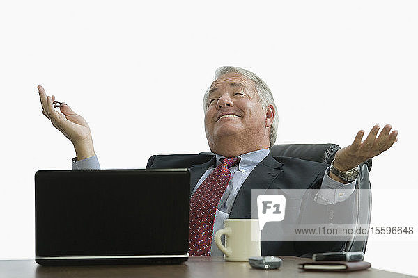 Businessman sitting in an office and smiling