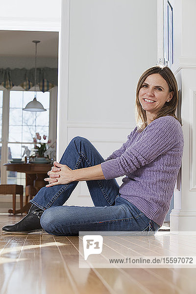 Woman sitting on the floor at home