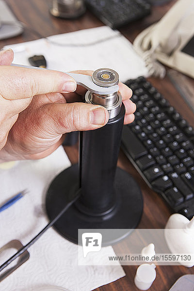 Engineer putting on retaining ring in an O2 electrochemical sensor probe in a laboratory