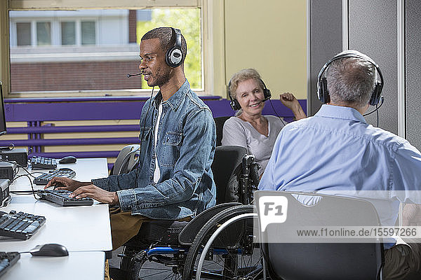 Man who had Spinal Meningitis in a wheelchair working in a call center